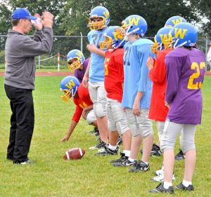 picture of a coach giving instructions to the players